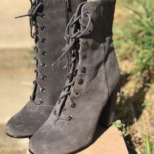 Grey heeled combat boots